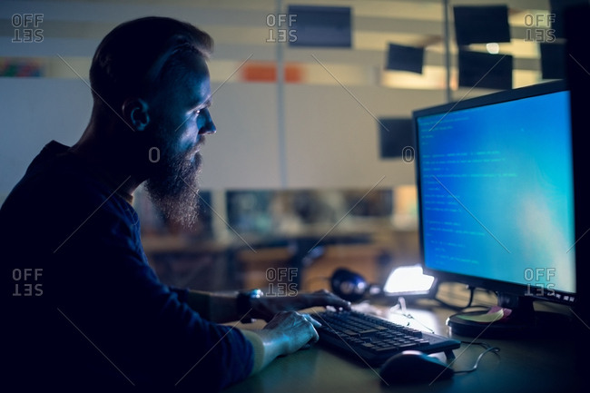 Attentive executive working on personal computer at desk in office