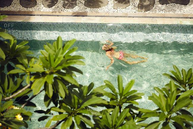 Woman in pool in Bali