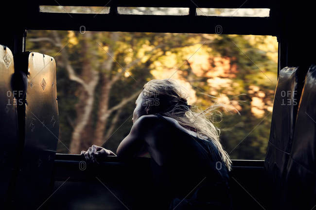 Woman leaning out a train window