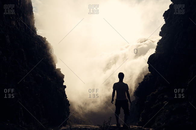 Man silhouetted by mountains in South Africa