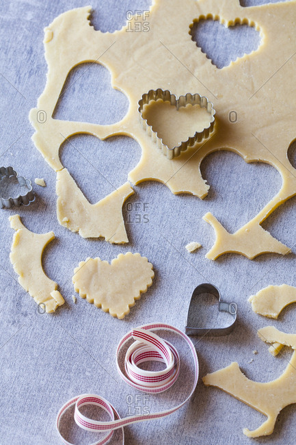 Heart-shaped cookie dough cut outs