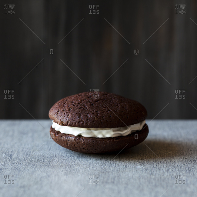 A whoopie pie sitting on a table