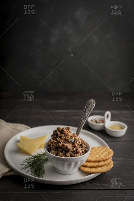 Olive tapenade with cheese and crackers