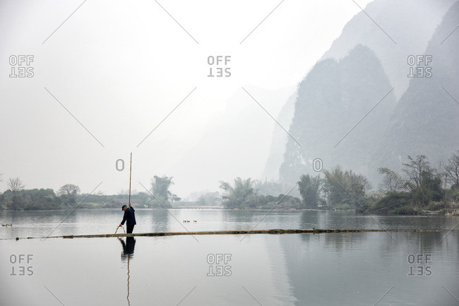Lone fisherman on a lake in Guilin