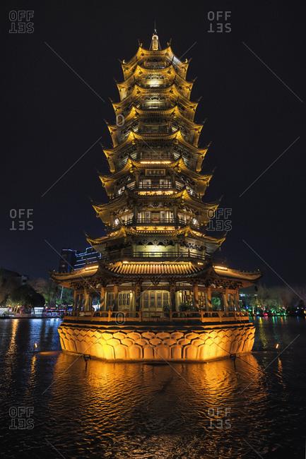Guilin, China - February 26, 2017: Moon pagoda at night on Shanhu Lake in Guilin