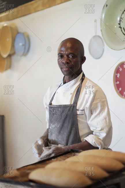 Johannesburg, South Africa - July 5, 2017: Baker working in commercial kitchen