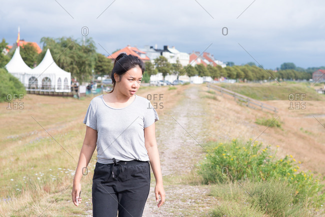 Woman walking on trail in park