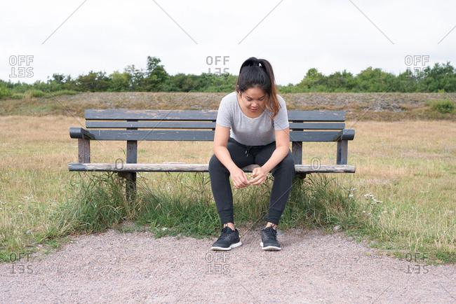 Woman taking a break on park bench