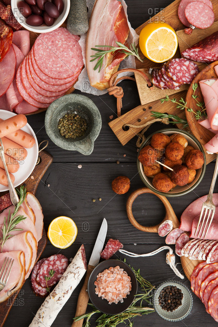 Arrangement of cured meats on table