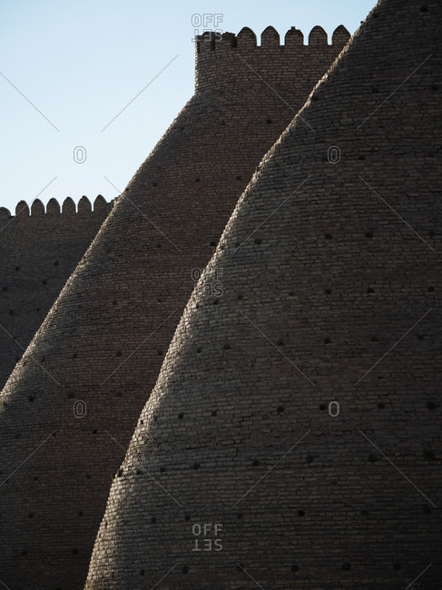 Fortified walls at Ark of Bhukara at sunset, Uzebekistan