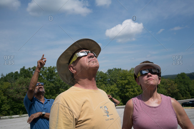 De Soto, Missouri, USA - August 21, 2017: Eclipse watchers wearing solar filter glasses enjoy the total eclipse