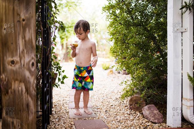 Toddler boy holding a cupcake