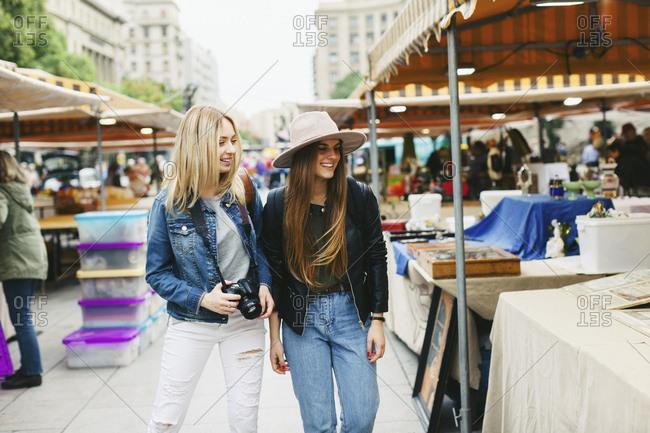 Spain- Barcelona- two young women on flea market
