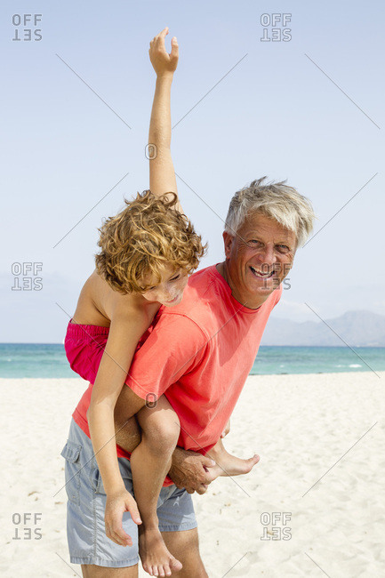 Spain- Grandfather giving piggyback ride to grandson- smiling