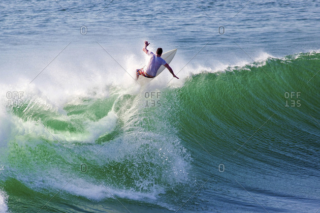 Indonesia- Bali- Surfer on wave