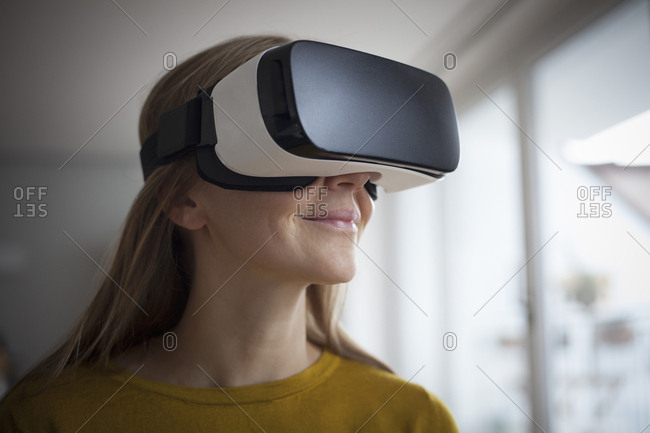 Smiling woman wearing Virtual Reality Glasses