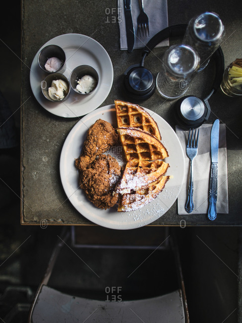 New York, United States of America - April 8, 2017: Unusual breakfast combination with fried chicken and waffle at Nas and John Seymour�s �Sweet Chick� Restaurant. The new trend is a savory-and-sweet combo, which is a must try when coming to New York