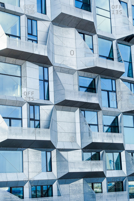 Copenhagen, Denmark - April 2, 2017: The Danish studio COBE has transformed a grain-storage silo located in Nordhavn into a modern apartment block with faceted facades. The area Nordhavn in Copenhagen used to be an old industrial harbor which turns into - luxury oasis for the locals