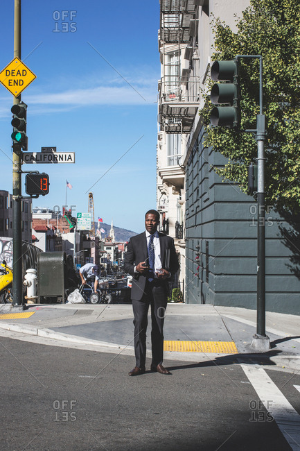 San Francisco, United States of America - October 18, 2016: Business man is standing and talking on phone on a street in San Francisco
