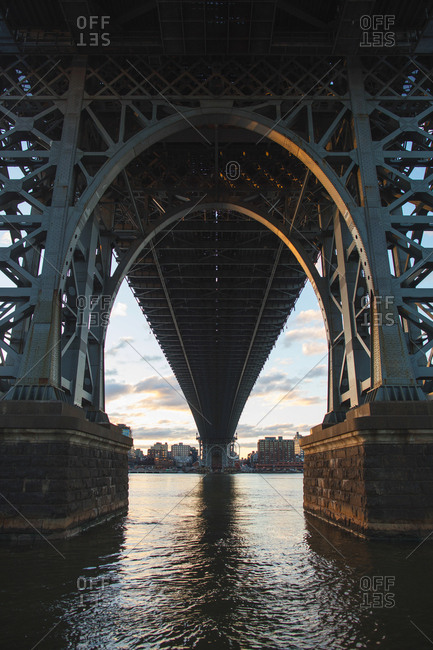 New York, United States of America - April 8, 2017: View under the Manhattan Bridge, which is a suspension bridge that crosses East River in New York. The bridge connects lower Manhattan with Brooklyn and was designed by Leon Moisseiff