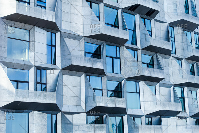 Copenhagen, Denmark - April 2, 2017: The Danish studio COBE has transformed a grain-storage silo located in Nordhavn into a modern apartment block with faceted facades. The area Nordhavn in Copenhagen used to be an old industrial harbor which turns into a luxury oasis for the locals