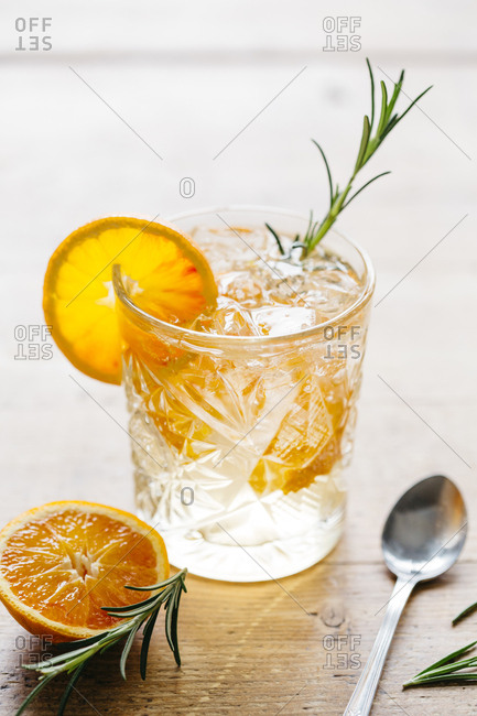 Refreshing frizzy orange drink, mocktail, with natural light