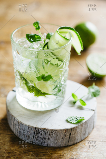 Fresh frizzy cucumber drink with cucumber, mint and lime, with natural light