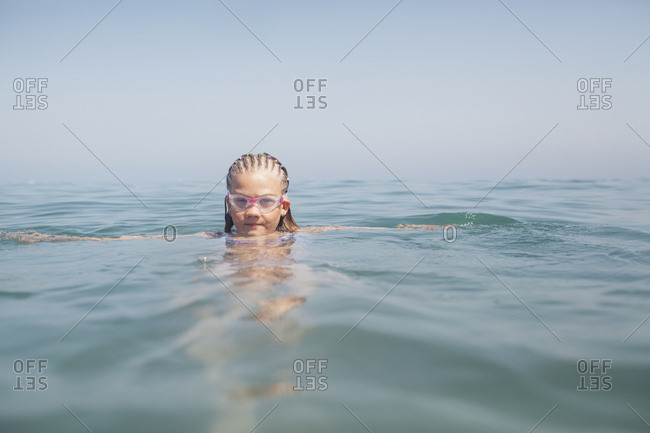 Underwater and beach shoot with a young girl in Torremolinos, Malaga, Spain. Freediving and swimming in the pool and sea. Surreal, dreamy pictures.