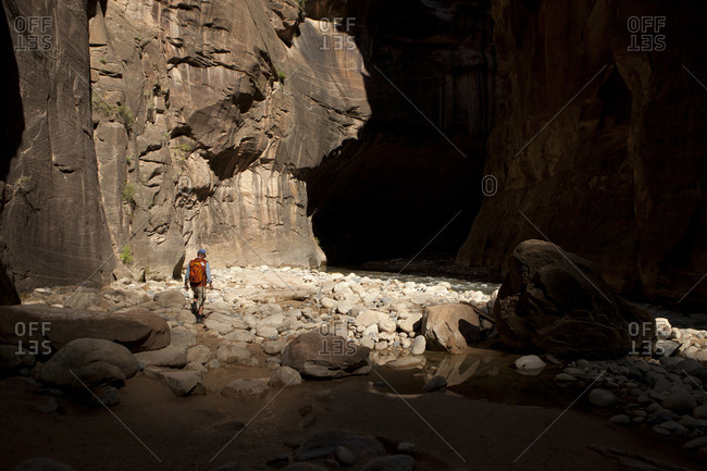 Lone hiker in The Narrows of Zion National Park