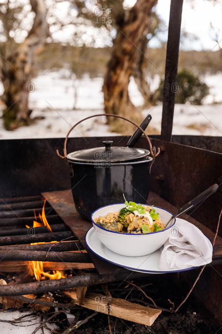 Food on outdoor fire in winter