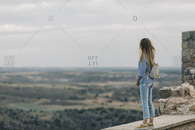 Woman looking at view from Gormaz Castle in Spain