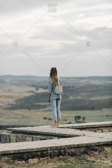 Rear view of woman looking at view from Gormaz Castle in Spain