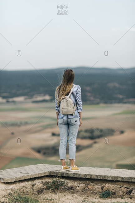 Rear view of young woman looking at view from Gormaz Castle in Spain
