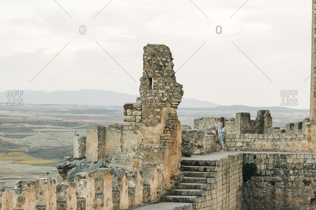 Woman exploring Gormaz Castle in Spain