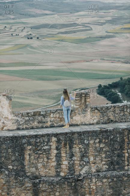 Woman overlooking countryside from Gormaz Castle in Spain