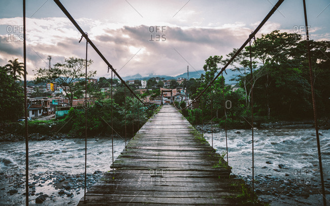 Mocoa, Putumayo, Colombia - April 8, 2015: Footbridge over rushing waters