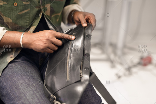 Man making a leather bag