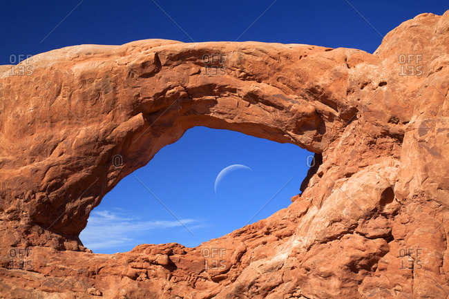 West Window formation with moon - Moab, Utah