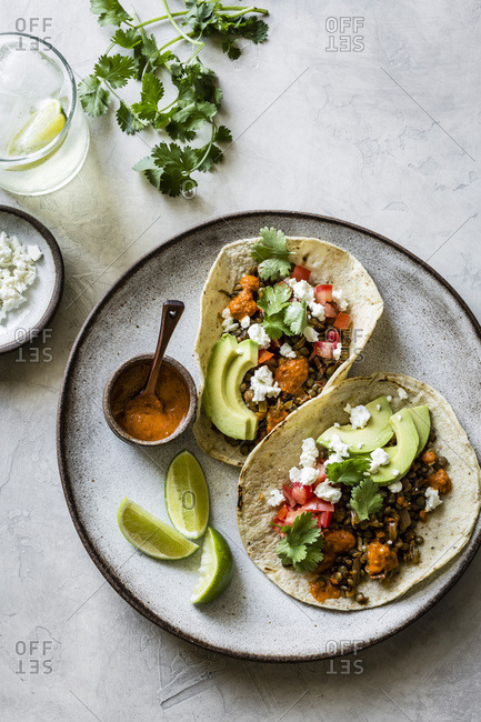 Smoky Lentil Tacos served with lime and water