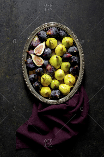 Fresh Figs in a metal tray on a black background
