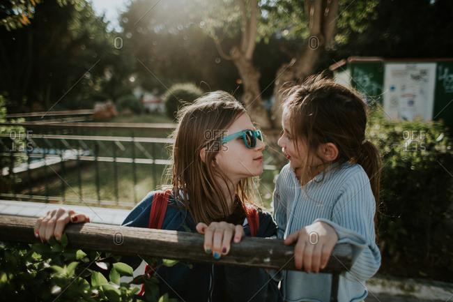 Girl giving younger sister a kiss, Crete, Greece