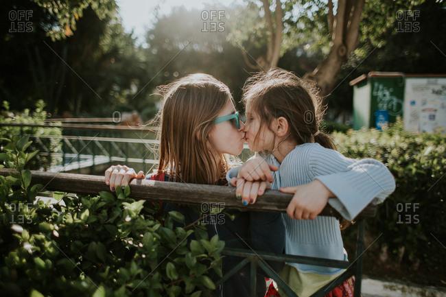 Sisters kissing, Crete, Greece - Offset