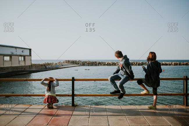 Kids on a pier in Crete, Greece