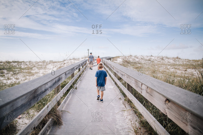 Boys walking to beach