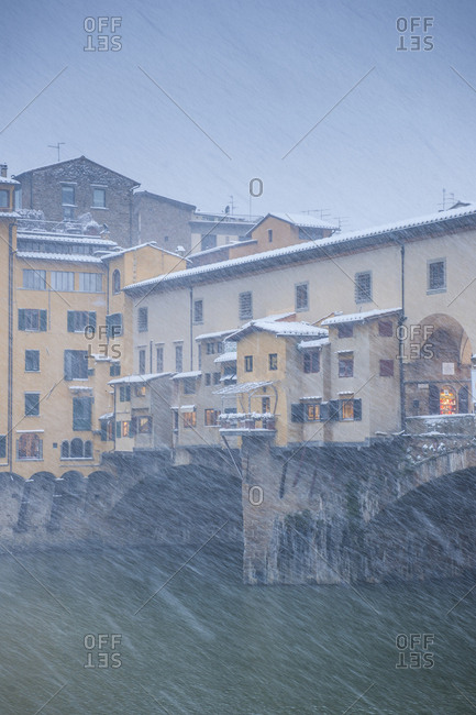 Florence, Tuscany, Italy - March 4, 2017: Ponte Vecchio in a snowstorm