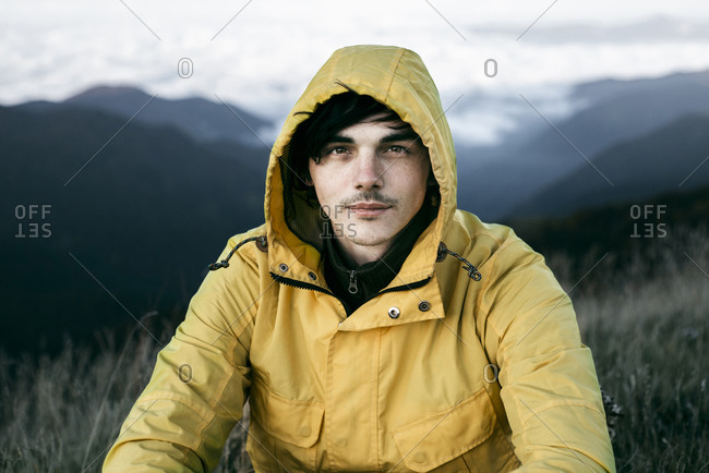 Portrait of Caucasian man in remote mountain landscape