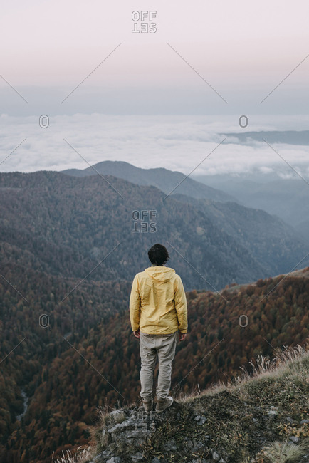 Caucasian man standing in remote mountain landscape