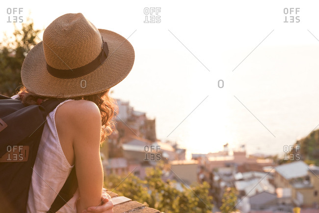 Caucasian woman enjoying scenic view of Manarola, Liguria, Italy