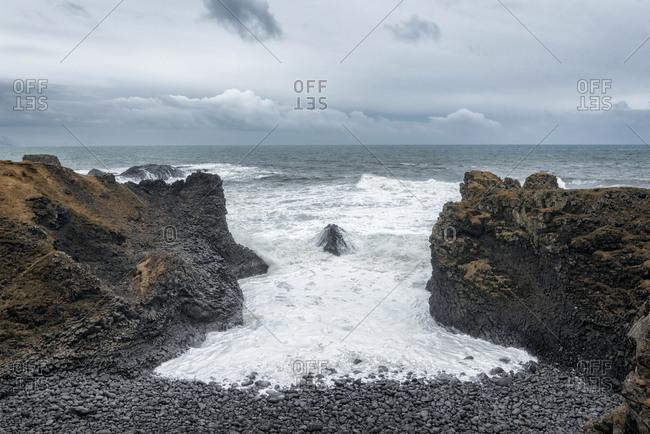 Rocks on beach near ocean, Hellissandur, Snaellsnes peninsula, Iceland