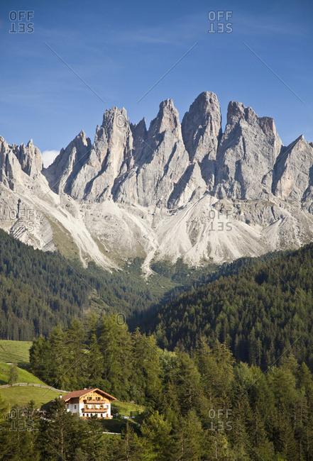 House in remote mountain landscape, Funes, Trentino Alto Adige, Italy